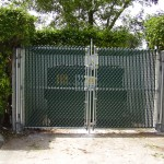 GALVANIZED CHAINLINK GATES WITH GREEN PRIVACY SLATS