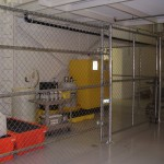 GALVANIZED CHAIN LINK ENCLOSURE WITH A ROLLING GATE
